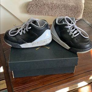Black and gray Jordan flights